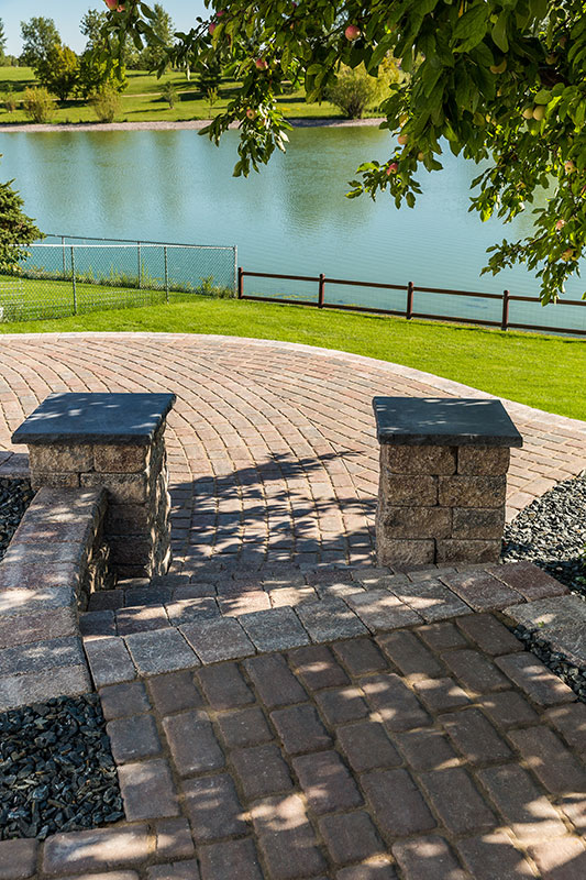 cobble paver path with lake